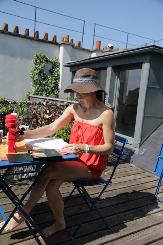 Doing my drawing homework on our deck